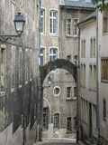 Arch in Luxembourg. Small narrow street leading down with arch over it, found in the old city of Luxembourg Royalty Free Stock Photos