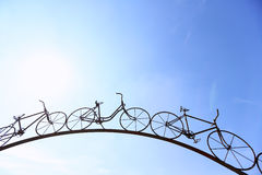 Arch madeof steel in shape of bicycle Royalty Free Stock Photos