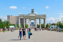Arch of Main Entrance of Exhibition of Achievements of National Economy, Moscow, Russia. MOSCOW, RUSSIA - JULY 23, 2016: Unknown people go to Exhibition of Royalty Free Stock Photography
