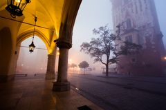 Arch on the market square in Krakow at morning fog Royalty Free Stock Photos