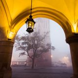 Arch on the market square in Krakow at morning fog Stock Photos