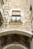 Arch in medieval alley. Balcony over arch in medieval street of the old town of Girona,  Catalonia, northeastern Spain Stock Image