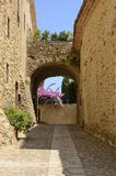 Arch in medieval alley. Arch in stone alley in the medieval village of Pals, located in the middle of the Emporda region of Girona, Catalonia, Spain Stock Photography