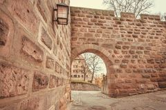 Arch of medieval Bavarian castle of Nuremberg with brick walls, built during Roman Empire in Germany.  Royalty Free Stock Photography