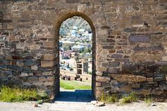 Arch in the medieval stone wall. Summer stock image