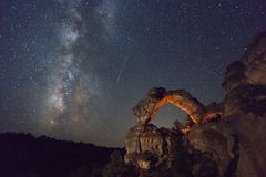 An arch with the milky way during the Persieds meteor shower, Utah, USA. Stock Photo