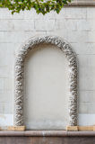 Arch molding decorates on the plain concrete wall Royalty Free Stock Photography