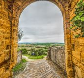 Arch in Monteriggioni city wall. Tuscany, Italy Royalty Free Stock Photos