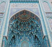 The arch of the mosque in blue tones is made from the mosaic of the Islamic religion. Stock Images