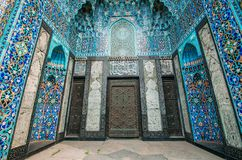 The arch of the mosque in blue tones is made from the mosaic of the Islamic religion. The arch of the mosque in blue tones is made from the mosaic of the Royalty Free Stock Photography