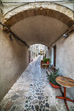 Arch in a narrow alley in Castelsardo. Sardinia Royalty Free Stock Photo