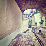 Arch. Narrow Alley with Arch in Italian City of Cetara, Instagram Effect Stock Photos