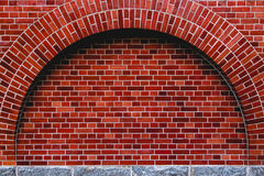 Arch od red brick wall artistic background, regular texture.  Royalty Free Stock Images