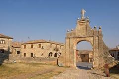 Arch ofSanta Maria la Real church and square,. Arch of Santa Maria la Real church and square, Sasamon, Burgos province, Spain Stock Photo
