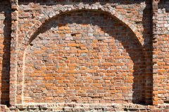 Arch in the old red brick wall stock images