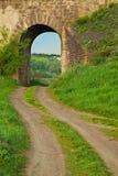 Arch in the old stone railway bridge Stock Photos