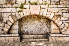 Arch in the old stone wall Stock Image