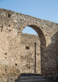 Arch in Old Stone Wall in Pompeii. Ancient brick arch in lost city of Pompeii royalty free stock images