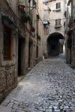 Arch On The Stonepaved Garzotto Street In Rovinj Royalty Free Stock Image