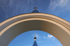 Arch, orthodox crosses, sky, light, symbols, belief. Stock Image