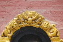 Arched Hindu Temple Doorway, Kathmandu, Nepal. This is an arch over a doorway to a Hindu Temple near Kathmandu, Nepal royalty free stock images