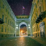 Arch over Galernaya street. Saint-Petersburg. The flag of the Russian Federation on the roof. stock image