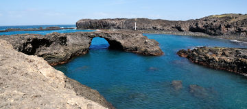 Arch over ocean. Baia a natural oasis made of a volcanic arch over a clear blue water lagoon serves as one of the natural wonders of the the island of Fogo, part Royalty Free Stock Photos