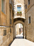 Arch over old narrow street of  city.  Girona Stock Photography