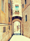 Arch over old narrow street of  city.  Girona Stock Image