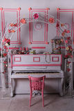 Arch over piano. Beatiful Arch with pink flowers over piano royalty free stock image