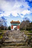 Arch over rock stairs, Nara Peace Park, Canberra, Australia. Gilt ornate archway over stone steps in Nara Peace Park, Canberra, Australia against blue skies royalty free stock image