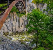 Arch over the St. John River. The St John River in Grand Falls, New Brunswick, Canada flowing over boulders below the dam taken from above with the arch of the Royalty Free Stock Image