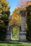 Arch in a park. Photo of old arch with decorative stone head in a fall park Stock Image