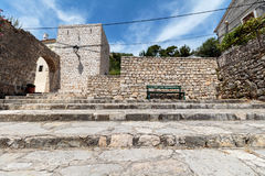 Arch passage. An sitting bench on top of stairs in old Dalmatian town of Novigrad Stock Photography
