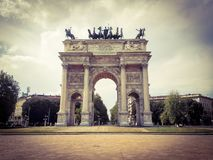 Low angle view of historical building Arch of Peace of Gate Sempione an ancient entrance of the city of Milan in Italy. stock photo