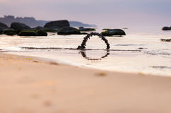 Arch of pebbles on the beach. Arch of pebbles on the sandy beach of the sea Stock Photo