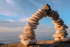 Arch of pebbles. Pebbles in the form of a arch on the coast Stock Photography