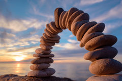 Arch of pebbles Stock Photography