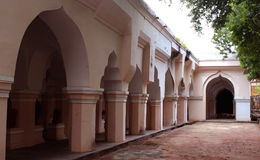 Arch with people hall pillars of the thanjavur maratha palace. The Thanjavur Maratha Palace Complex, known locally as Aranmanai, is the official residence of the stock images