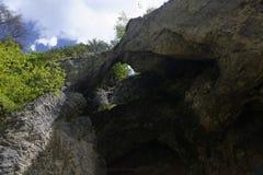 Arch at Pestera Lui Ionele Cave, Apuseni Mountains, Romania. Stone archway at Pestera Lui Ionele Cave in Apuseni Mountains in Transylvania, Romania Royalty Free Stock Photos