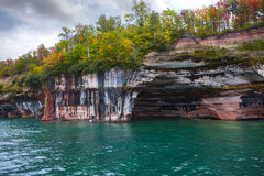 Arch Pictured Rocks. Pictured Rocks Arch with colorful textured and trees royalty free stock image