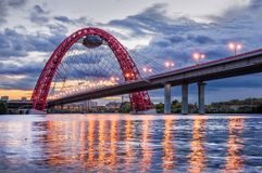 Arch of the Picturesque Bridge. The Arch of the Picturesque Bridge in Moscow on a summer cloudy evening and the reflection of lanterns in the Moscow River stock photos
