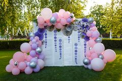 Arch of pink and purple balloons for girl happy birthday party.