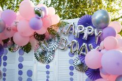 Arch of pink and purple balloons for girl happy birthday party. Outdoors summer event. Festive decorative elements