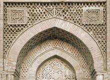 Arch portal of a mosque, Uzbekistan. Carved ornament of an arch portal of a mosque, Uzbekistan Stock Photos