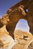 The arch from red sandstone in desert Stock Photo