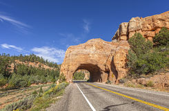 Arch road tunnel on the way to Bryce Canyon National Park, USA. Royalty Free Stock Photo