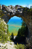Arch Rock. On Mackinac Island in Michigan. It is a natural limestone arch that stands on the Lake Huron shoreline 146 feet above the water Stock Images