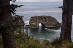 Arch Rock in Oregon. Arch Rock view from hiking trail in Samuel Boardman state park in South Oregon Stock Photo
