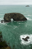 Arch Rock Pacific Ocean Oregon Coast United States. Surf crashes up against Arch Rock off the Oregon Coast Stock Photos